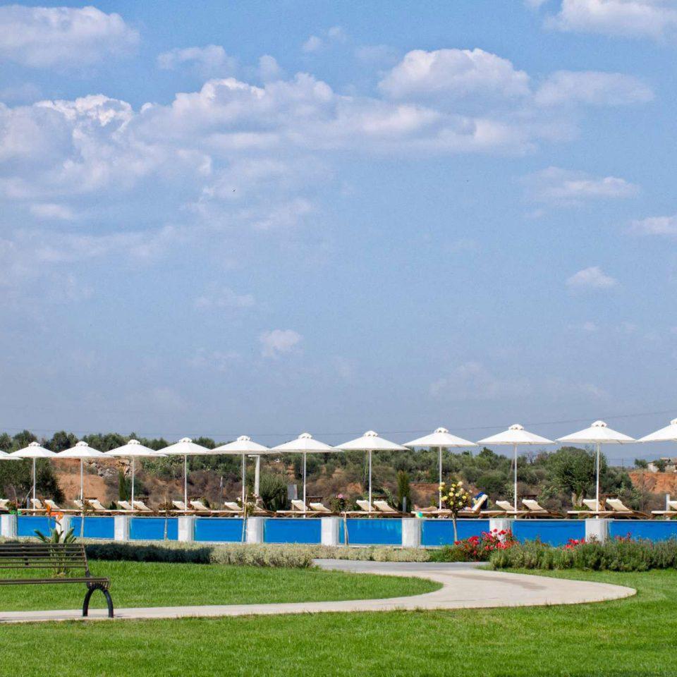 grass sky structure sport venue stadium swimming pool Resort