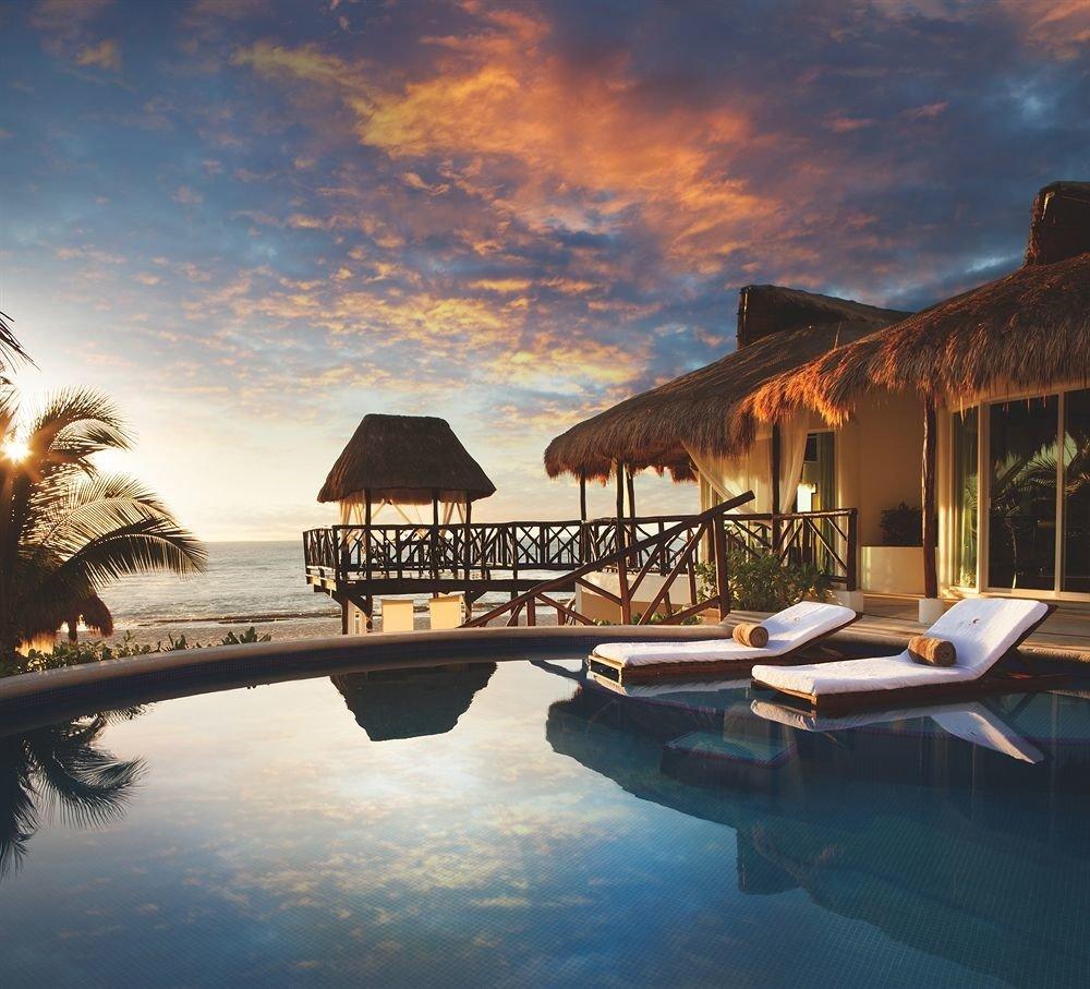 water sky swimming pool Resort evening Sunset Sea dusk Villa lined shore day