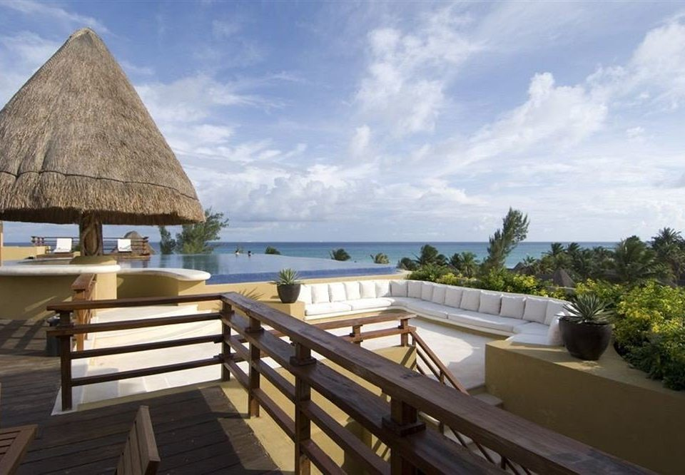 sky building property wooden Villa Resort swimming pool Sea overlooking cottage roof day