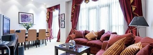 sofa curtain property Suite Resort living room arranged