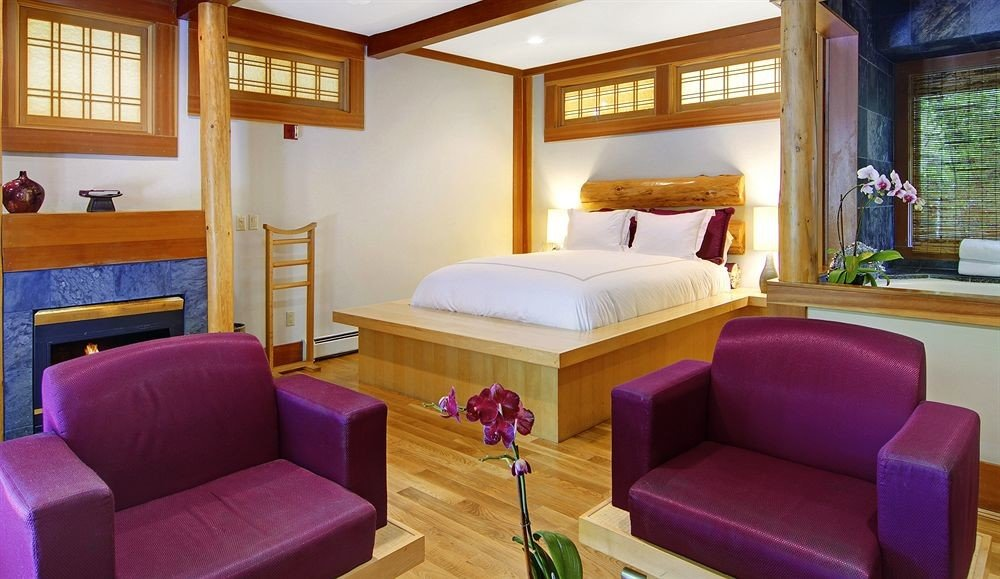 sofa property Suite Resort living room cottage purple colored