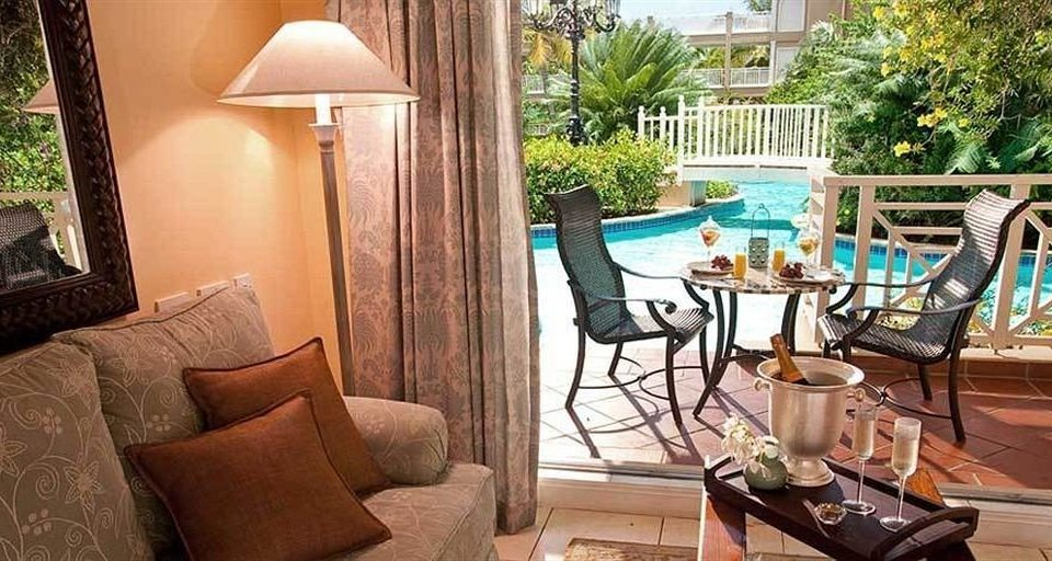 chair property home Villa Resort living room cottage mansion condominium Suite hacienda backyard