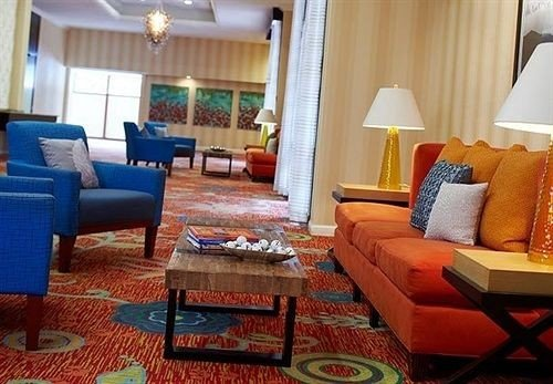 sofa living room property Suite cottage home condominium Resort bed sheet Villa blue rug