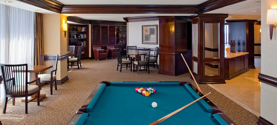 pool table poolroom pool ball recreation room billiard room chair property scene Suite Resort Villa gambling house