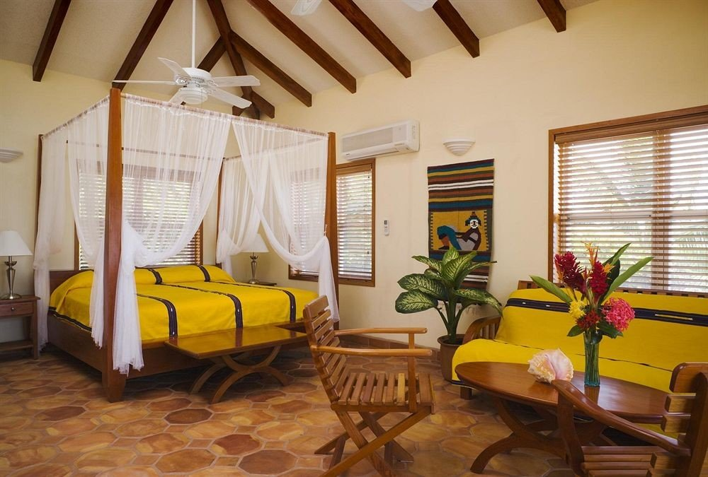 yellow property building Villa cottage Resort home Suite living room