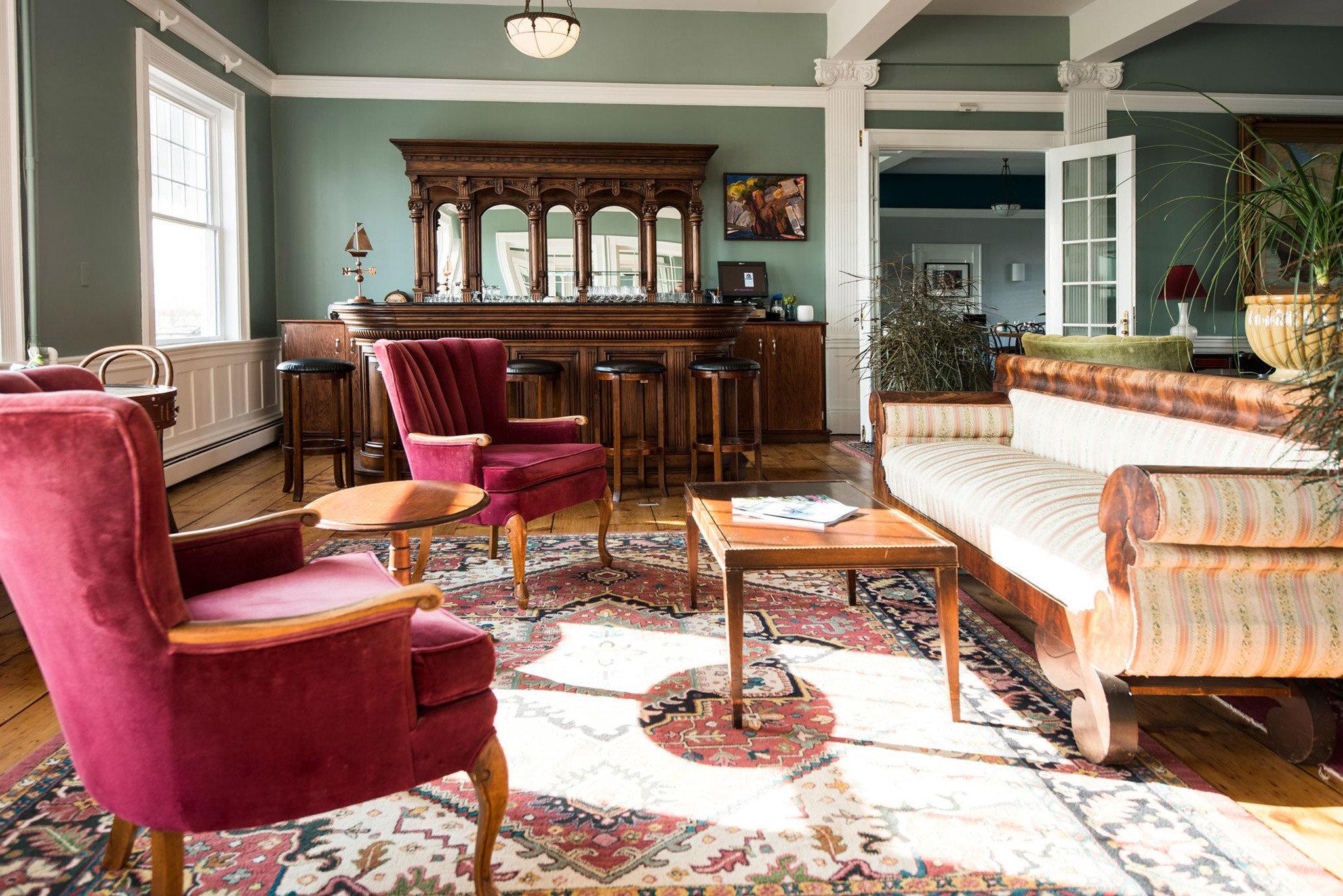 chair property living room home cottage Villa mansion porch Resort Suite farmhouse