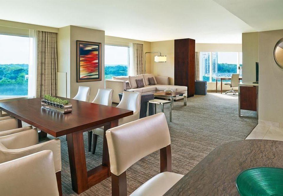 chair property condominium Suite living room Resort home Villa dining table