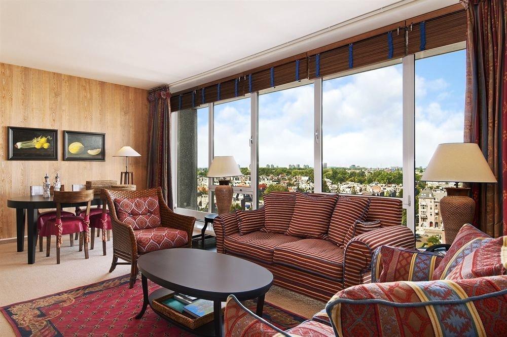 chair property living room Suite Resort home Villa condominium cottage