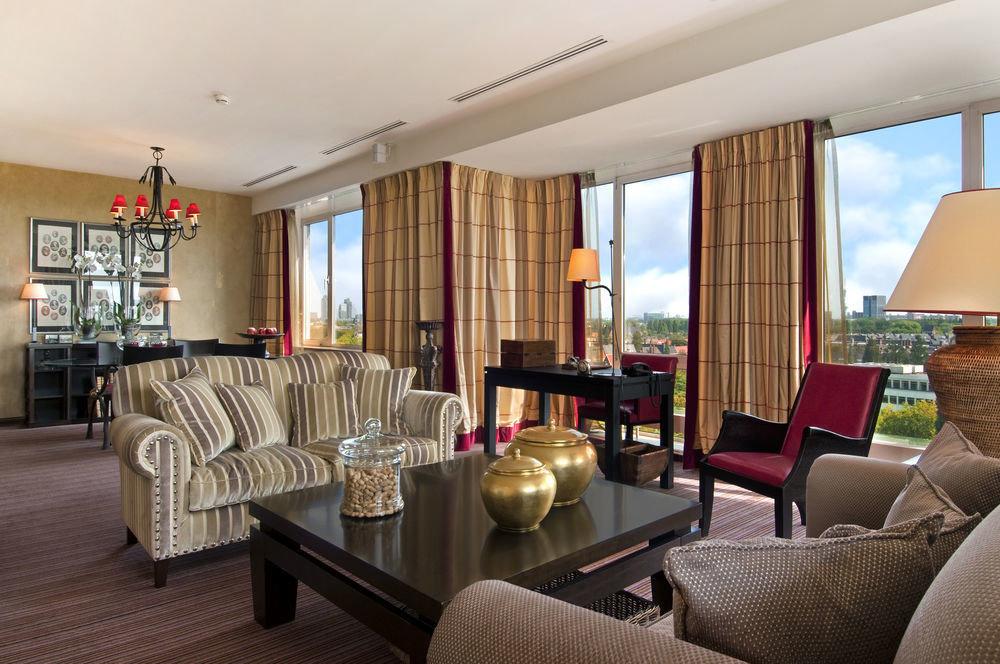chair property living room condominium home Suite Resort Villa cottage