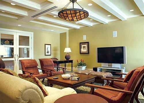 chair sofa living room property condominium home hardwood recreation room Suite cottage Villa Resort leather