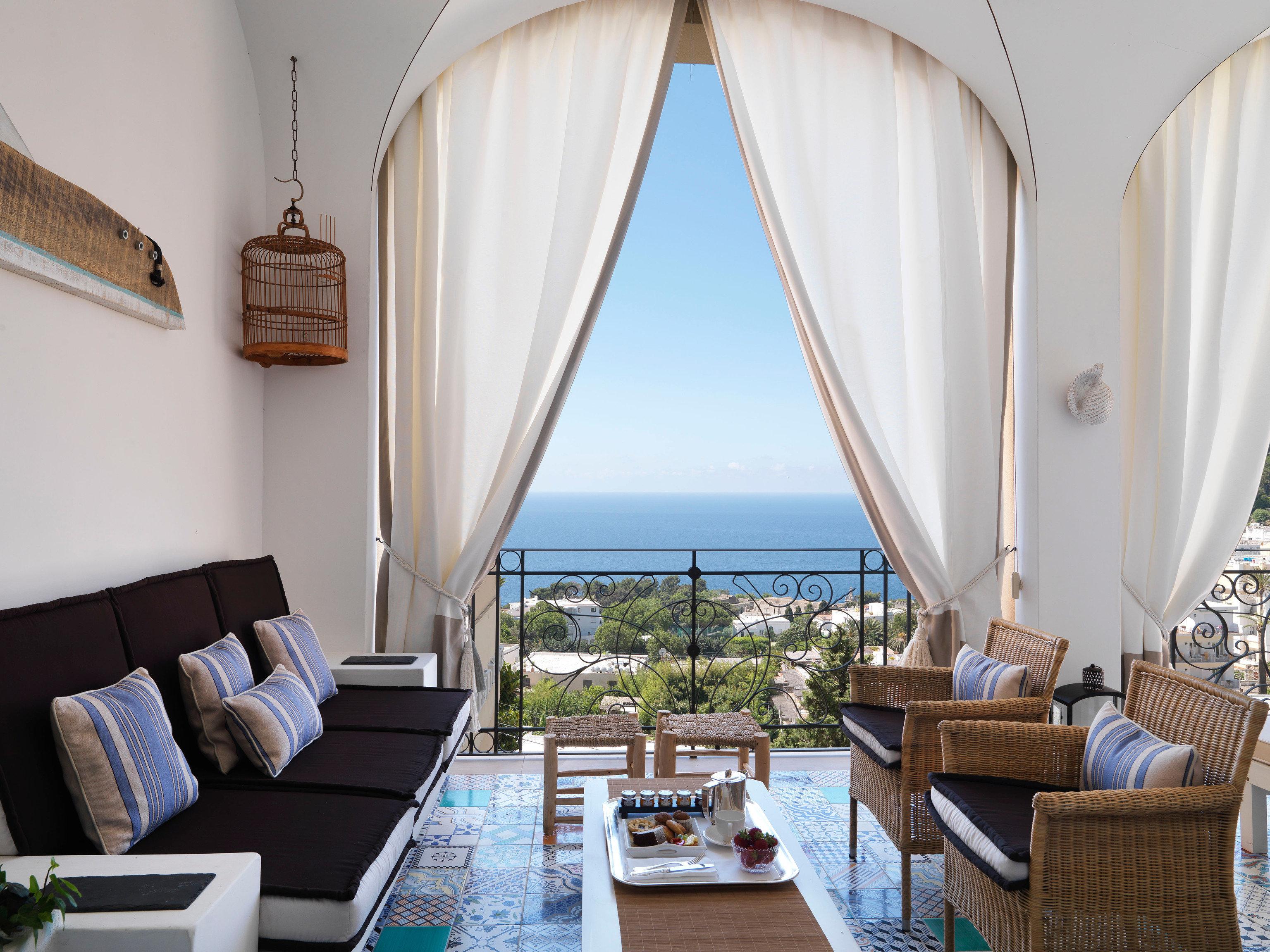 chair property Suite Resort Villa living room cottage home