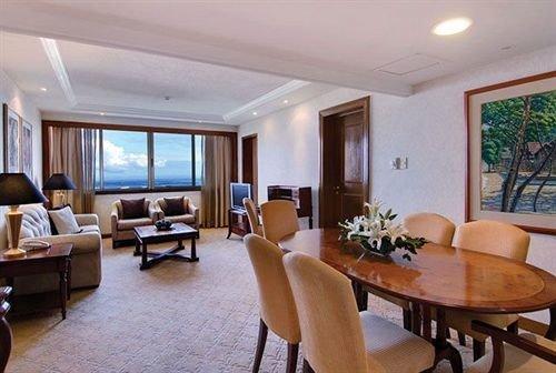 chair property condominium living room Resort Suite Villa dining table