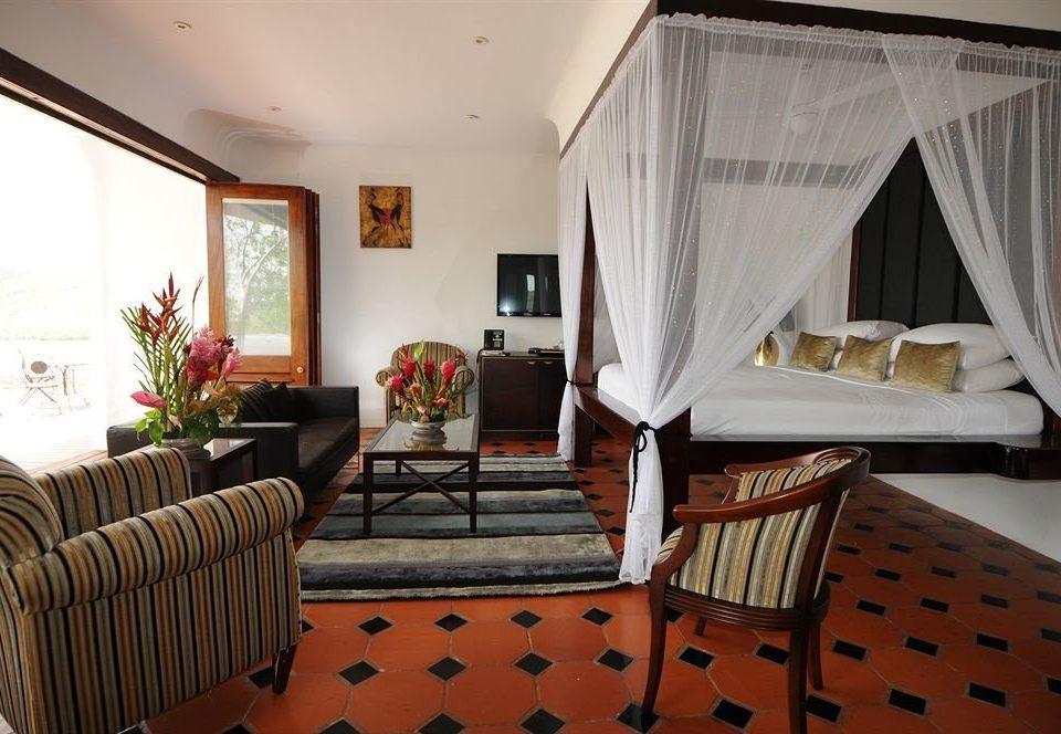 chair property living room Suite cottage home Villa Resort