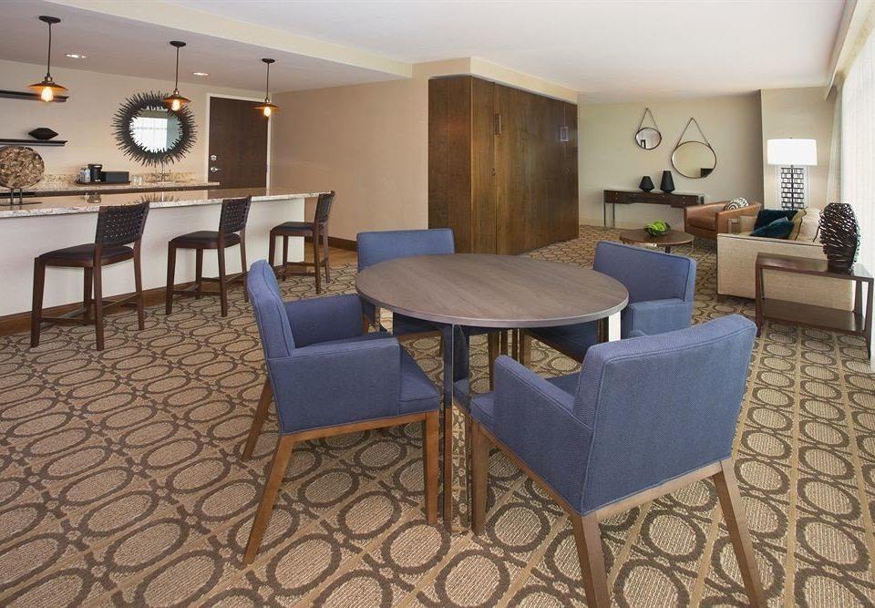 chair property Suite condominium Villa cottage living room Resort