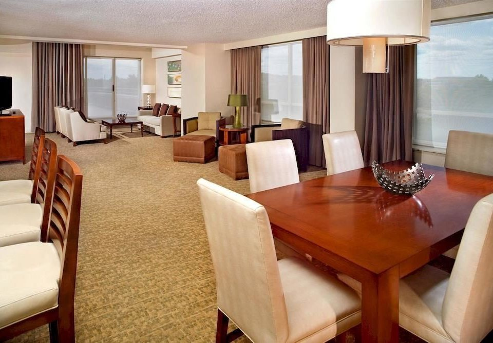 sofa chair property Suite condominium Resort Villa cottage living room dining table