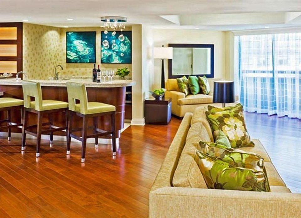 property condominium home living room hardwood Suite wood flooring Resort cottage Villa flooring hard dining table