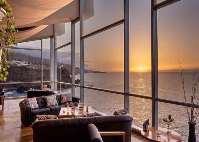 water property Resort overlooking condominium restaurant home lighting yacht living room Suite Villa