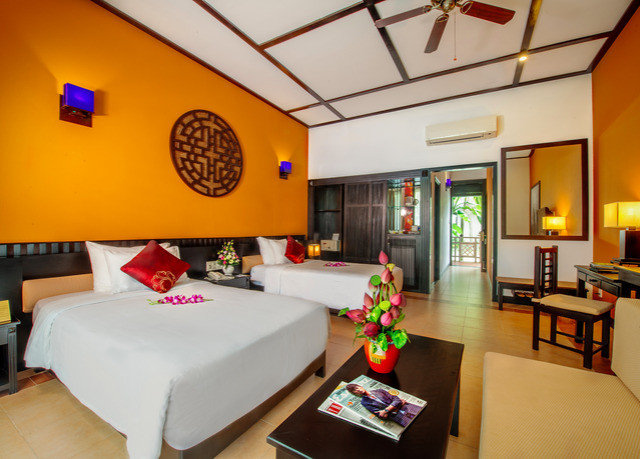 yellow property recreation room Resort Suite orange living room cottage Villa