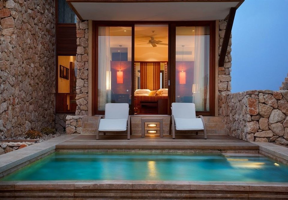 swimming pool property stone mansion home Villa living room Resort Suite jacuzzi