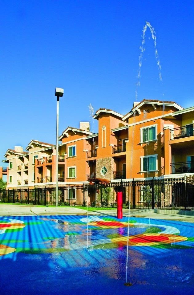 sky leisure swimming pool Resort Town plaza marina condominium cityscape dock colorful