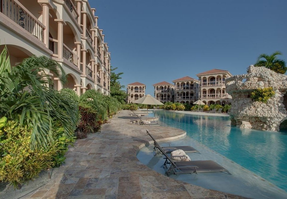 building property house swimming pool Town Resort condominium Village Villa waterway lined surrounded