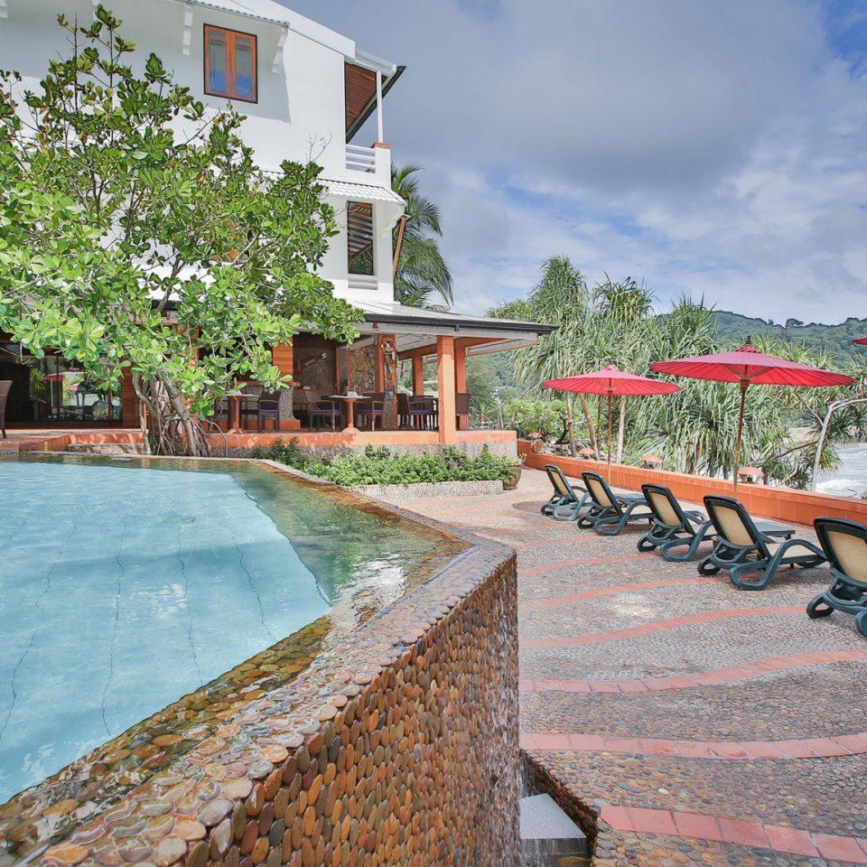 sky ground leisure property Town Resort swimming pool house Villa home Village hacienda walkway backyard stone