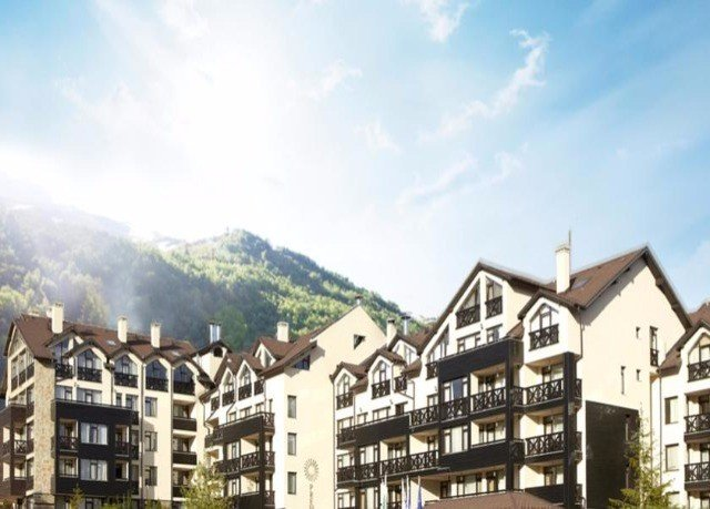 sky building Town property residential area neighbourhood mountain Village suburb tours Resort apartment building panorama mountain range cottage