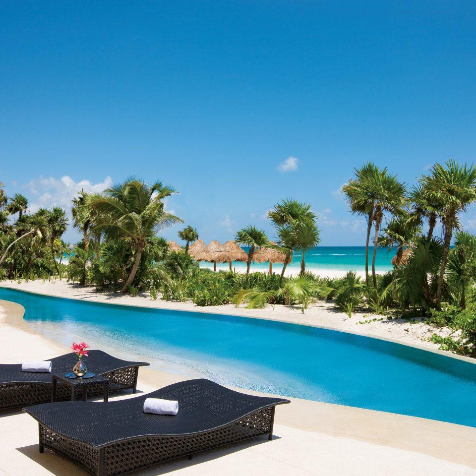 tree sky Resort swimming pool property leisure palm tree Villa arecales caribbean tropics house water amenity