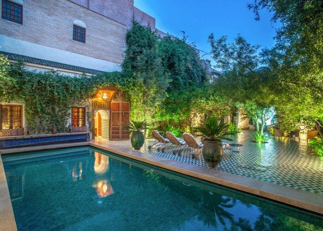 tree property swimming pool building home Resort leisure resort town Villa lighting backyard water feature hacienda landscape lighting landscaping house outdoor structure landscape mansion water amenity reflecting pool