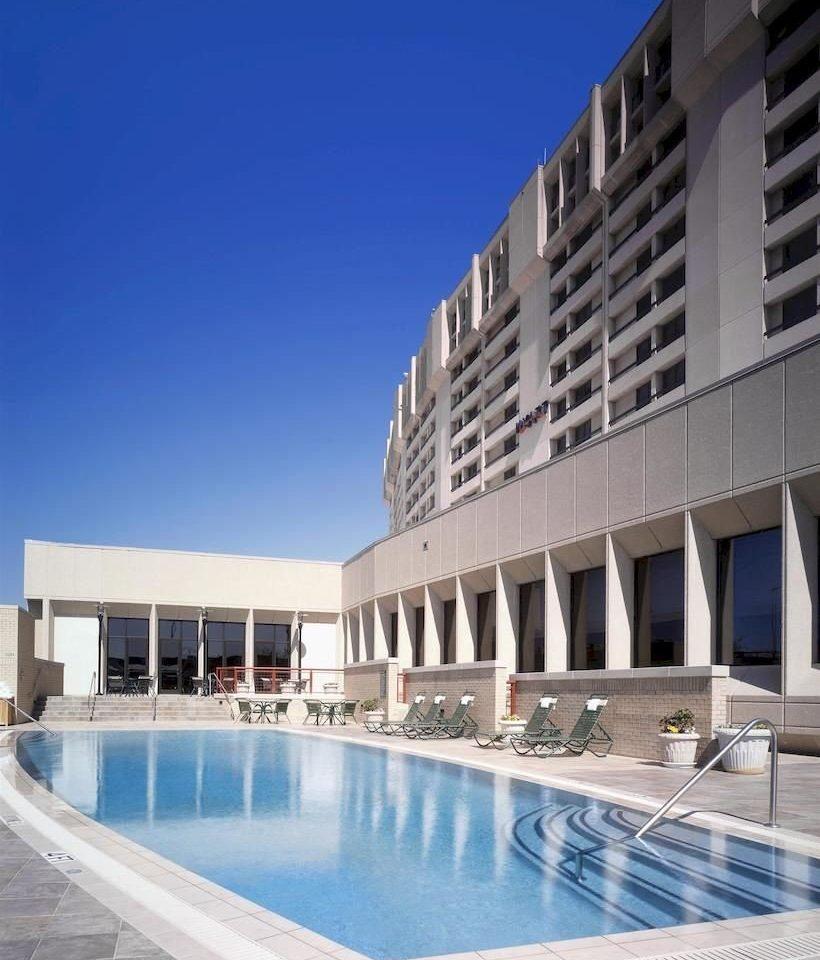 building sky swimming pool property condominium leisure centre Resort plaza convention center headquarters Villa apartment building colonnade