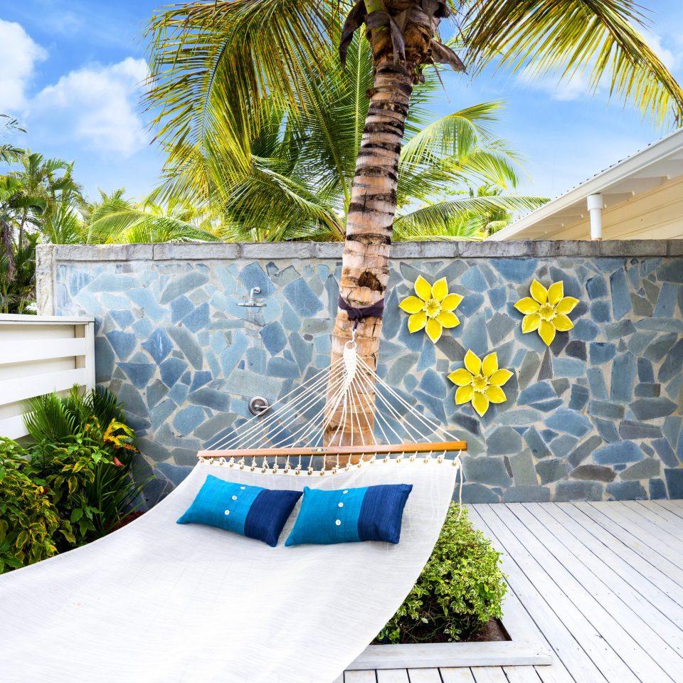 property arecales palm tree home tree house Resort backyard outdoor structure plant Villa tropics condominium leisure