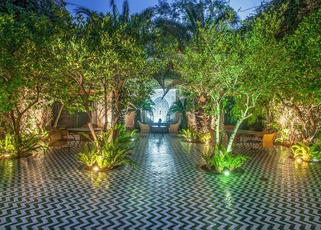 tree property vegetation majorelle blue arecales plant lighting Resort landscape palm tree water reflecting pool home outdoor structure backyard landscape lighting landscaping water feature plantation hacienda pond Villa watercourse leisure empty surrounded