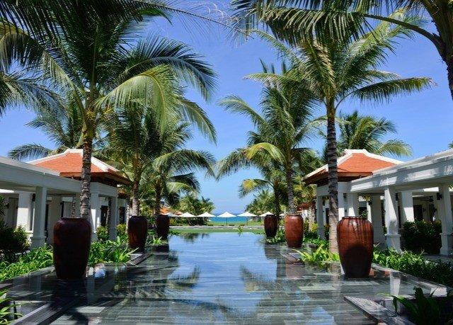 tree sky palm Resort property plant arecales condominium caribbean palm family Villa lined