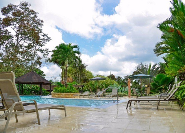 tree sky ground chair property swimming pool leisure Resort caribbean condominium Villa arecales lined sandy day