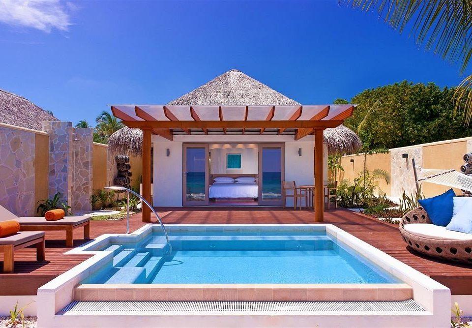 sky swimming pool property Villa Resort leisure mansion home hacienda backyard blue palace