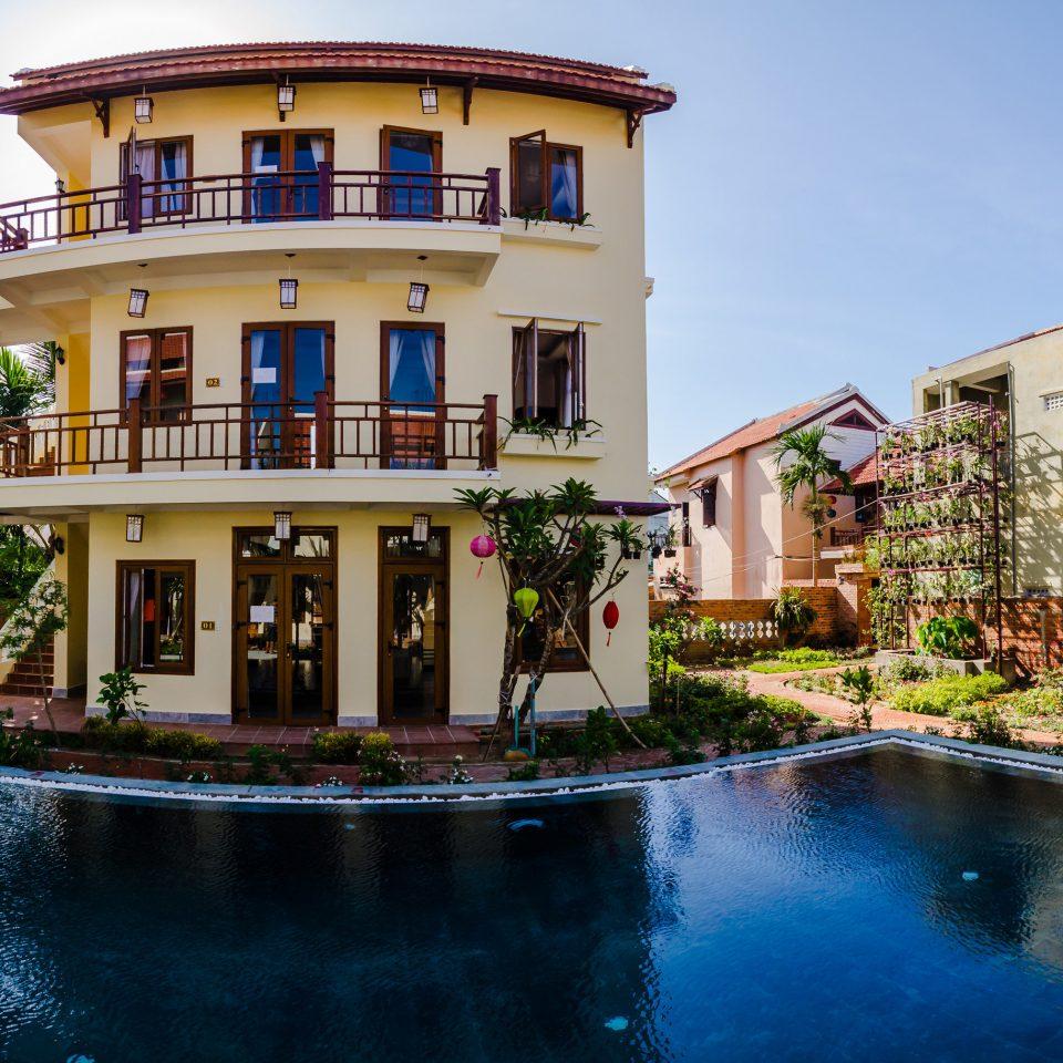 house property building swimming pool condominium home Resort mansion Villa backyard
