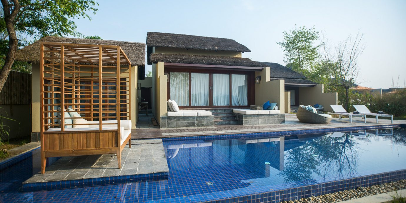 sky tree swimming pool property building house Villa home backyard Resort condominium outdoor structure cottage