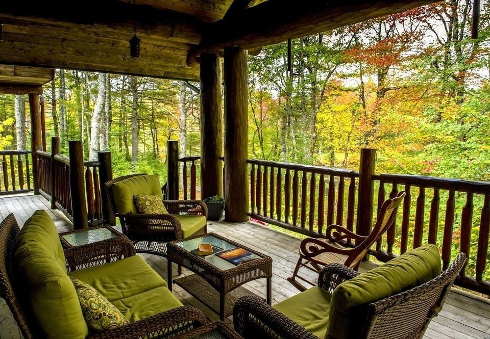 tree property porch building cottage Resort home Villa outdoor structure mansion farmhouse backyard living room hacienda log cabin