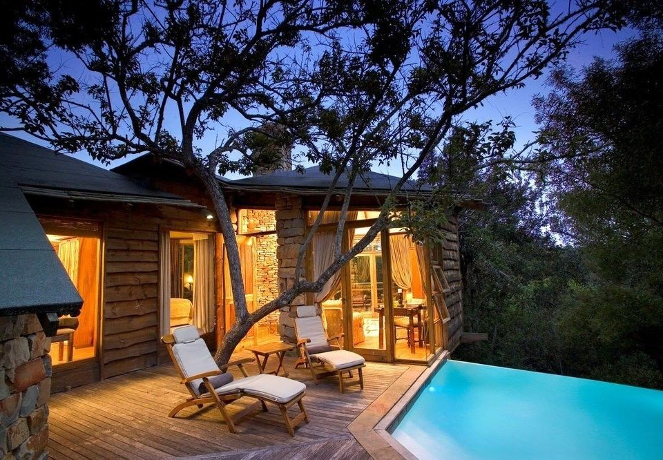 tree property building house backyard home Villa cottage swimming pool Resort outdoor structure log cabin farmhouse