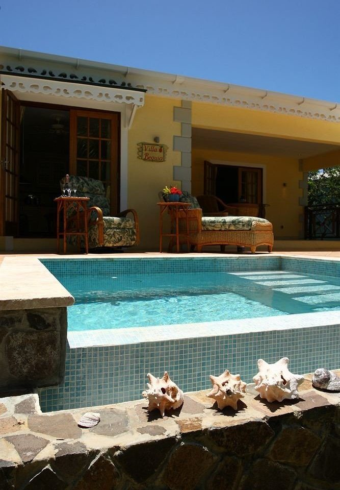 swimming pool property building house home Resort Villa backyard stone