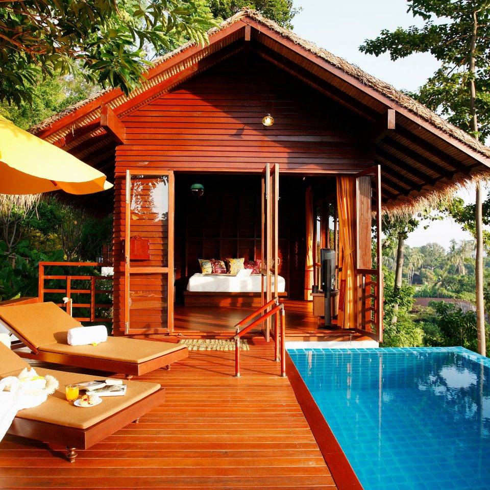 tree building house property swimming pool wooden Resort home Villa outdoor structure cottage backyard log cabin