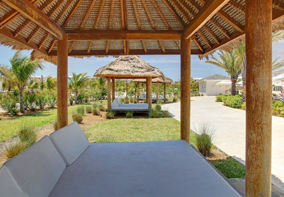 grass ground property building Villa gazebo Resort outdoor structure backyard home pavilion hacienda cottage eco hotel porch pergola swimming pool
