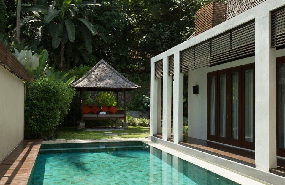 tree building property house swimming pool home Villa cottage backyard Resort condominium outdoor structure porch