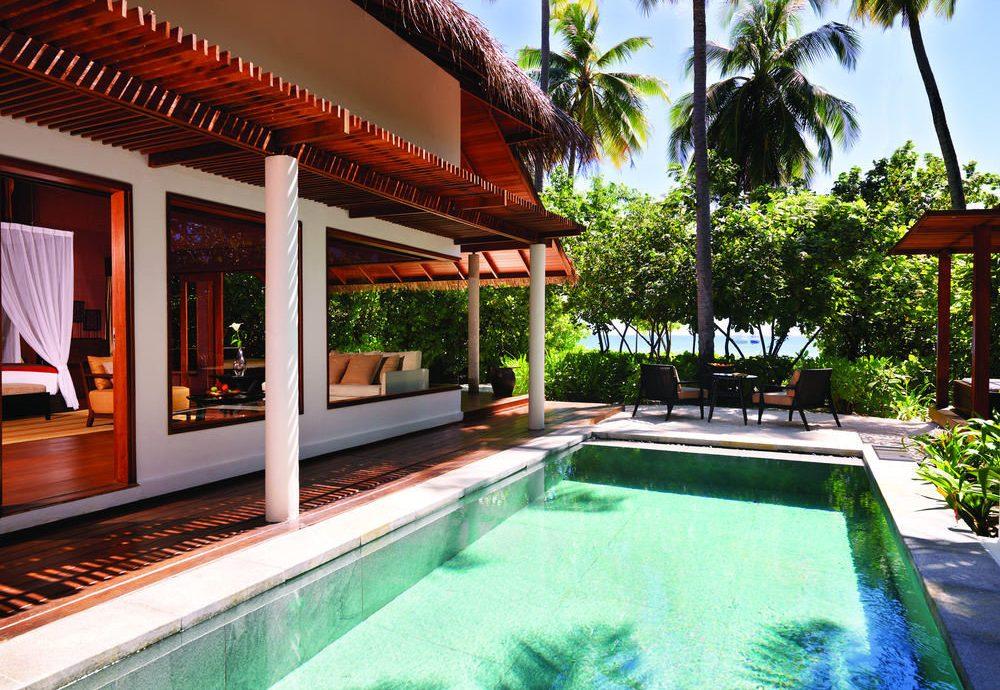 tree swimming pool building property Resort leisure Villa backyard hacienda eco hotel mansion palm