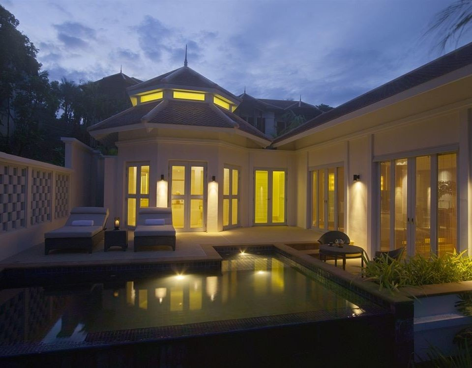 property building house home Villa mansion swimming pool yellow lighting condominium Resort landscape lighting backyard
