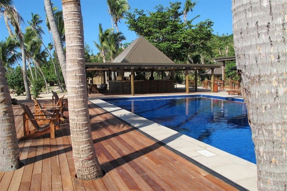 property swimming pool building wooden Villa Resort walkway outdoor structure cottage backyard stone