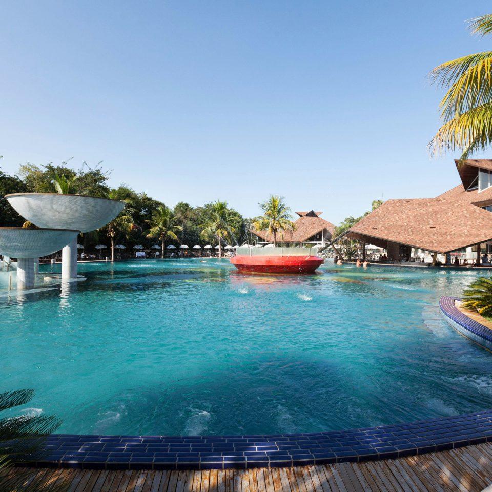 tree sky water swimming pool leisure property Resort green resort town Villa backyard caribbean swimming lined