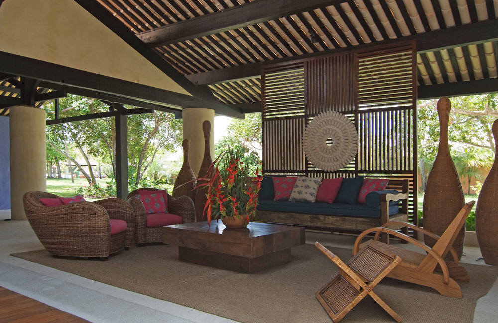 property chair porch Resort Villa outdoor structure home cottage backyard living room hacienda