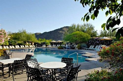 tree sky chair swimming pool property leisure Villa Resort backyard condominium overlooking lined shade sandy day