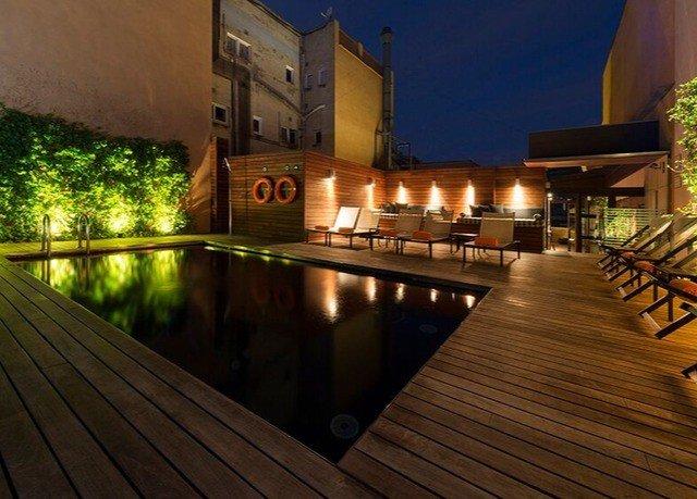 swimming pool property reflecting pool lighting Resort landscape lighting condominium mansion backyard outdoor structure Villa